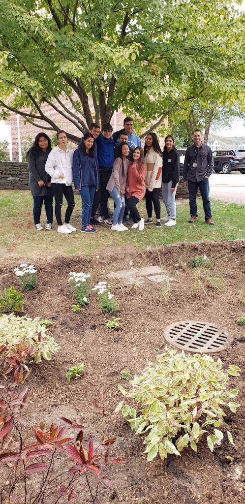 Earl L. Vandermeulen High School Environmental Club with adviser Jonathan Maletta (right). (Photo courtesy of Port Jefferson School District)