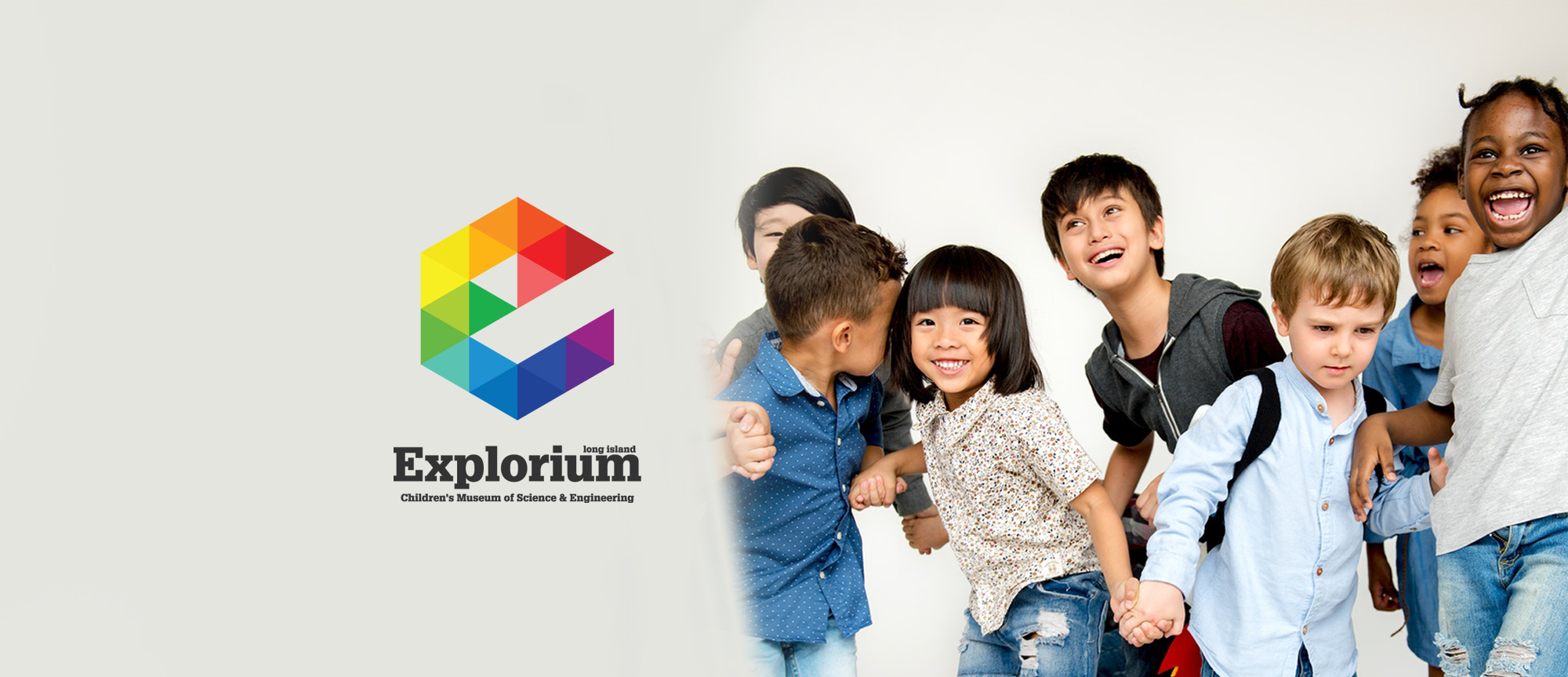 header image for the Long Island Explorium of a group of happy children